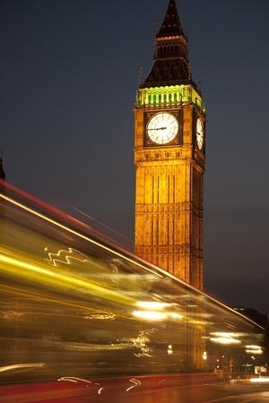 Big Ben and Bus in London illuminated at Night Stock Photo