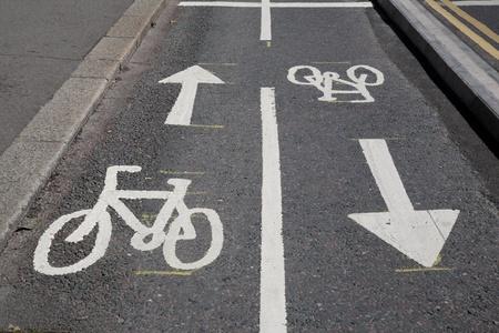 Bicycle Lane Symbols Painted on Tarmac Surface Stock Photo - 10431385