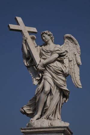 bernini: Statue on Pont Sant Angelo Bridge by Bernini, 17th Century, in Rome; Italy Stock Photo