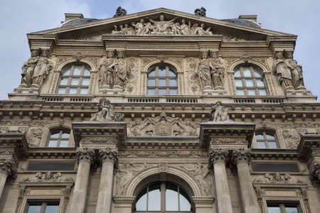 Facade of the Louvre Art Museum in Paris, France