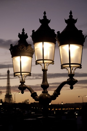 Eiffel Tower and illuminated at night in Paris, France Stock Photo