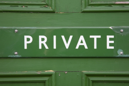 Private Sign on Green Door Stock Photo