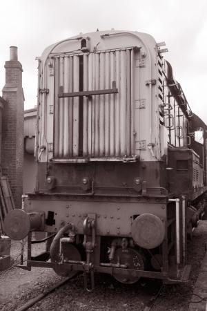 goods train: Goods Train Engine in Black and White Sepia Tone Stock Photo