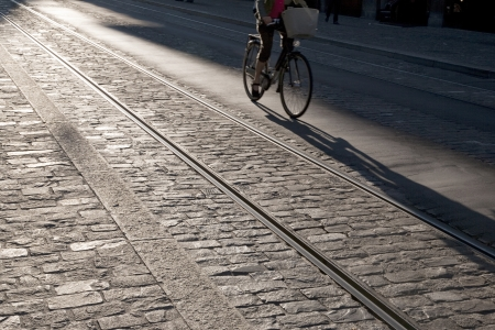 Cyclist on Cobbled Street with Tram Tracks Stock Photo - 15868577
