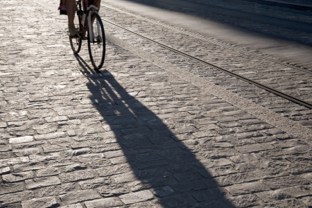 Cyclist on Cobbled Street in Bern, Switzerland Stock Photo - 15868575