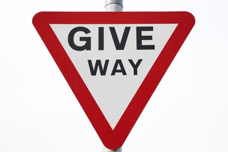 give way: Give Way Sign on White Background Stock Photo