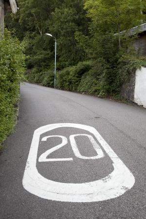 Twenty Mile Per Hour Speed Limit Markings on Rural Road Stock Photo - 16762010