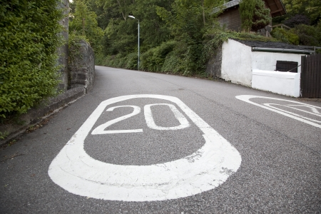 Twenty Mile Per Hour Speed Limit Marking on Rural Urban Road Stock Photo - 16762011