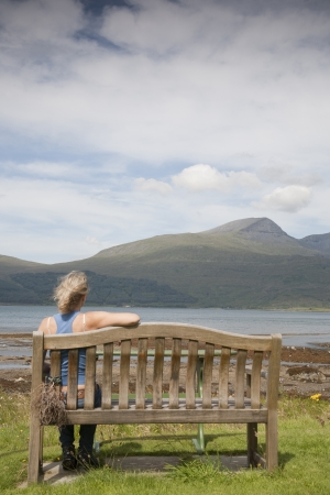 mull: Woman looking towards Mountains, Isle of Mull, Scotland, UK Stock Photo