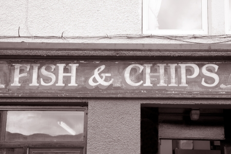 Fish and Chips Sign in Black and White Sepia Tone photo