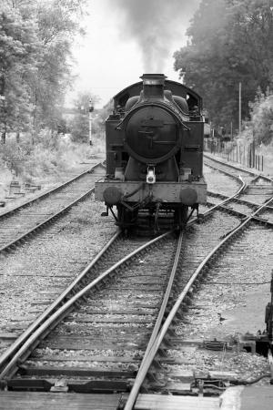 Old Steam Train Engine in Black and White Sepia Tone