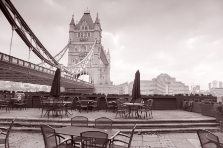 Tower Bridge in London and Cafe Terrace, England, UK in Black and White Sepia Tone photo