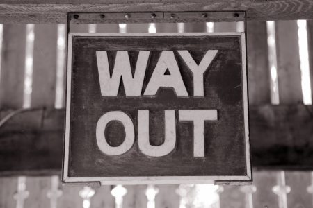 way out: Way Out Sign in Black and white Sepia Tone