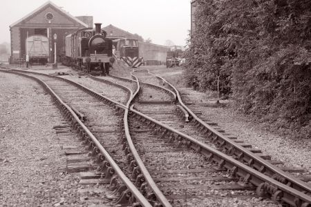 railway track: Railway Engine and Goods Shed in Black and White Sepia Tone