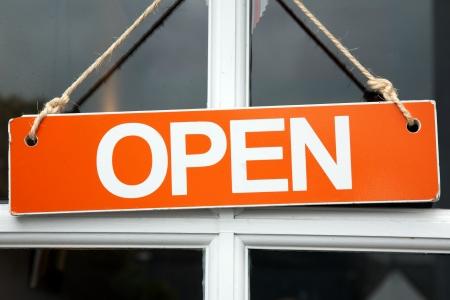 Orange Open Sign on Shop Door