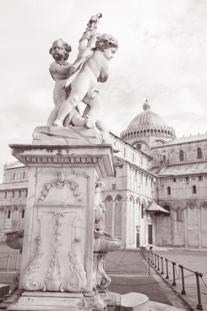 angels fountain: 18th Century Fountain with Angels - Fontana dei Putti and Cathedral in Piazza dei Miracoli Square, Pisa, Italy in Black and White Sepia Tone
