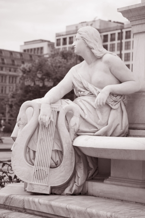 deatil: Deatil on the Schiller Statue outside Concert Hall, Berlin, Germany in Black and White Sepia Tone