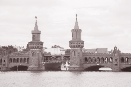 Oberbaumbrucke Bridge on River Spree, Berlin; Germany in Black and White Sepia Tone