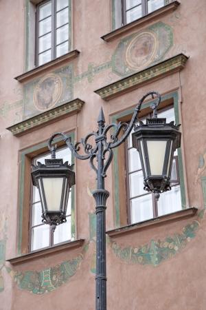 stare miasto: Design on Facade in Stare Miasto Neighbourhood with Lamppost, Warsaw; Poland Stock Photo