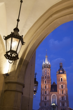 Cloth Hall and Lamp with Mariacka Basilica Church; Krakow; Poland, Illuminated at Night photo