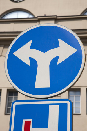seperation: Blue Two Directions Traffic Sign in Urban Setting