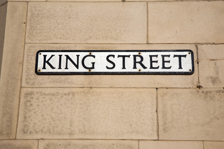 king street: King Street Sign on Brick Wall Stock Photo