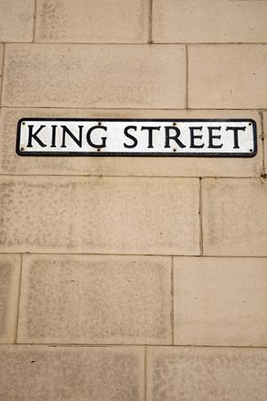 king street: King Street Sign on Brick Wall Stock Photo