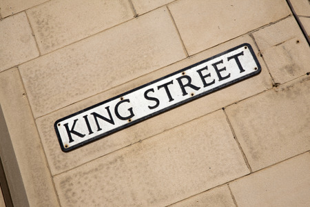 king street: King Street Sign on Brick Wall on Diagonal Tilt