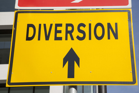 diversion: Yellow Diversion Sign in Urban Setting