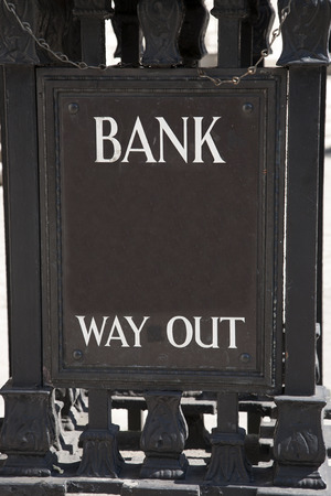 way out: Bank Way Out Sign in Urban Setting Stock Photo