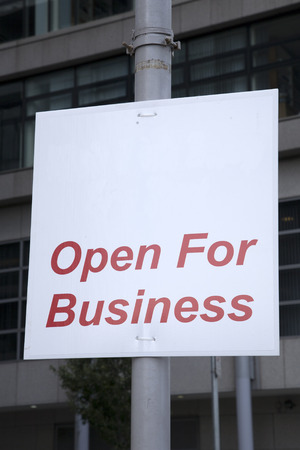 blank open for business sign in urban setting stock photo picture
