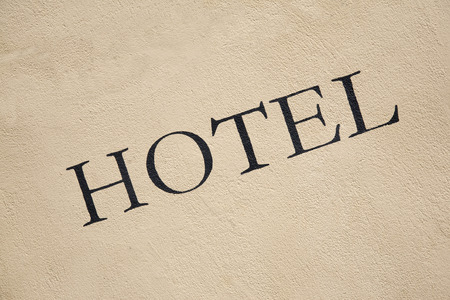 hotel building: Hotel Sign on Building Facade Stock Photo