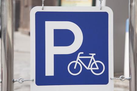 bike parking: Blue Bike Parking Sign in Urban Setting