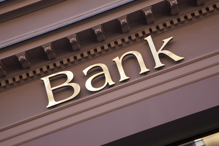 Bank Sign on Branch Facade 스톡 콘텐츠