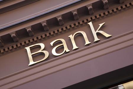 Bank Sign on Branch Facade Stock Photo