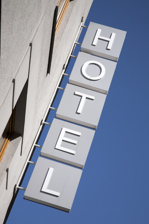 hotel building: Hotel Sign against Building Facade