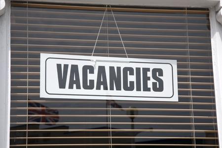 holidays vacancy: Vacancies Sign on Hotel Window