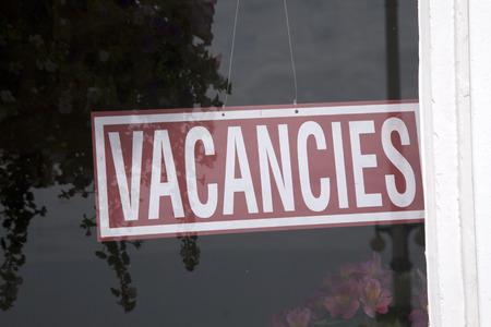 vacancies: Vacancies Sign on Hotel Window