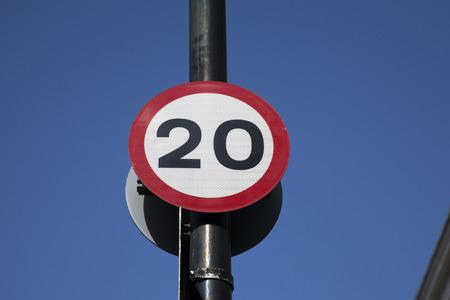 twenty: Twenty Speed Sign against Blue Sky Background Stock Photo