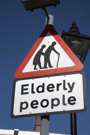 oap: Elderly People Sign against Blue Sky Background Stock Photo