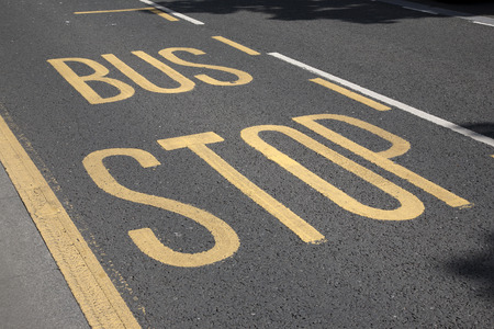 bus stop: Bus Stop Sign Painted on Road
