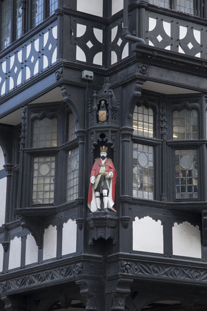 chester: Figure on Traditional Facade, Chester, England, UK