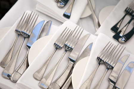 plate setting: Plate Setting with Fork, Knife and Spoon Stock Photo