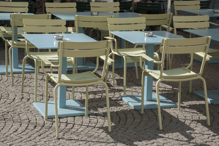 astray: Cafe Tables and Chairs on Cobbled Stones Stock Photo