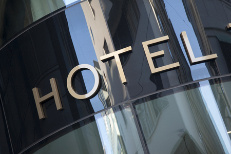 hotel: Hotel Sign in Urban Setting