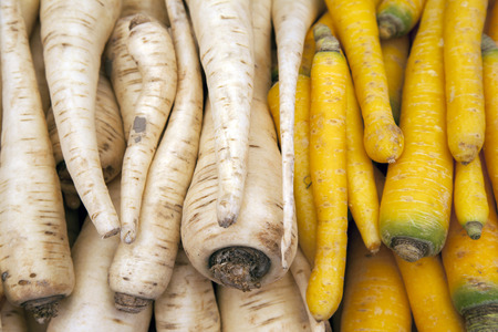 parsnip: White and Yellow Parsnip Background on Market Stall