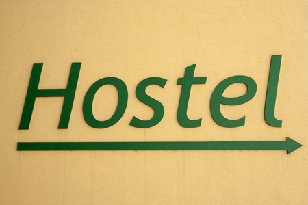 hostel: Hostel Sign on a Yellow Background