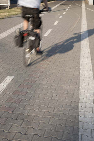 fast lane: Bike Lane with Cyclist in Urban Setting Stock Photo