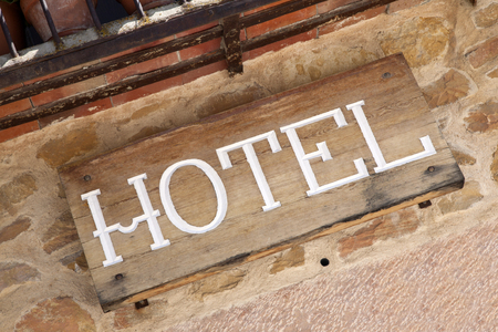 accommodations: Hotel Sign in Rural Setting Stock Photo