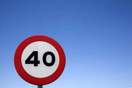 forty: Forty Speed Sign against Blue Sky Background